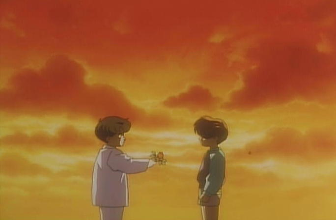 A screen capture of young Mamoru holding a rose out to young Fiore