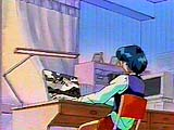 Small image of Ami sitting at her desk at home.
