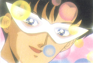 Tuxedo Mask with his eyes showing through the mask.